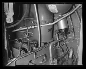 Primary view of object titled '[XH-40 engine showing cannon connections]'.