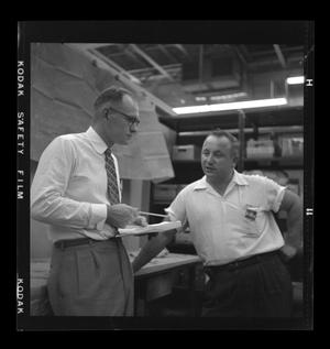Primary view of object titled '[Workers discussing the XH-40]'.