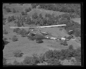 Primary view of object titled '[YH-40 #7 Olive Drab hovering]'.