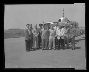 Primary view of object titled '[1st class H-40 mechanics standing with instructors]'.