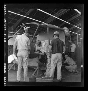 Primary view of object titled '[Bell employees working on the XH-40]'.