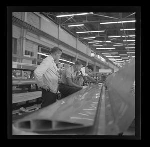 Primary view of object titled '[Bell employees working on parts for the XH-40]'.