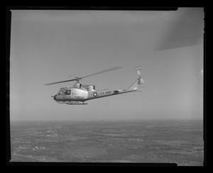 Primary view of object titled '[First flight of XH-40 #3 over the Hurst plant]'.