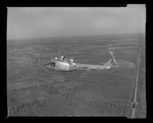 Primary view of object titled '[Rear view of XH-40 #3 during its first flight]'.