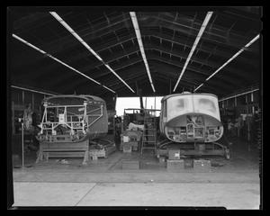 Primary view of object titled '[Two XH-40 helicopters under construction]'.