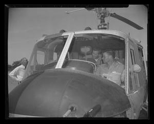 Primary view of object titled '[Officers sitting inside the H-40 at Hurst Heliport]'.