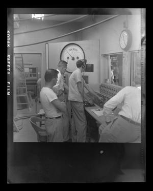 Primary view of object titled '[Bell employees standing in a control room]'.