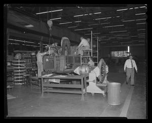 Primary view of object titled '[Bell employees working on the YH-40]'.
