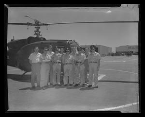 Primary view of object titled '[Crew of YH-70 #7 standing with Army personnel in front of helicopter]'.