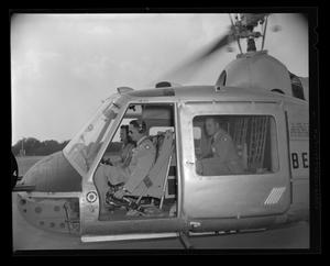 Primary view of object titled '[Colonel Inskeep and Army visitors inside of the XH-40]'.