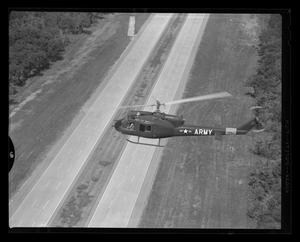 Primary view of object titled '[The YH-40 #7 flying over a freeway in Hurst, Texas]'.