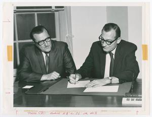 Primary view of object titled '[Two Men Reviewing Documents]'.