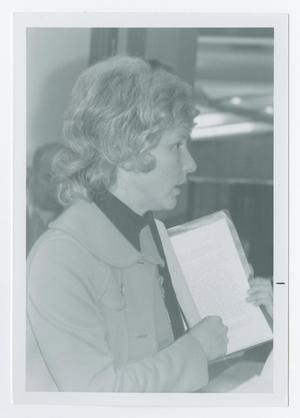 Primary view of object titled '[Ann Campbell Holding Sample Transcripts]'.