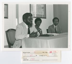 Primary view of object titled '[Three Speakers During a Panel Discussion]'.
