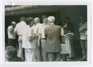 Primary view of object titled '[Several People Gathered Outside in Conversation]'.