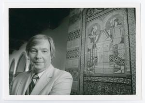 Primary view of object titled '[Dale Treleven In Front of Picture Wall]'.