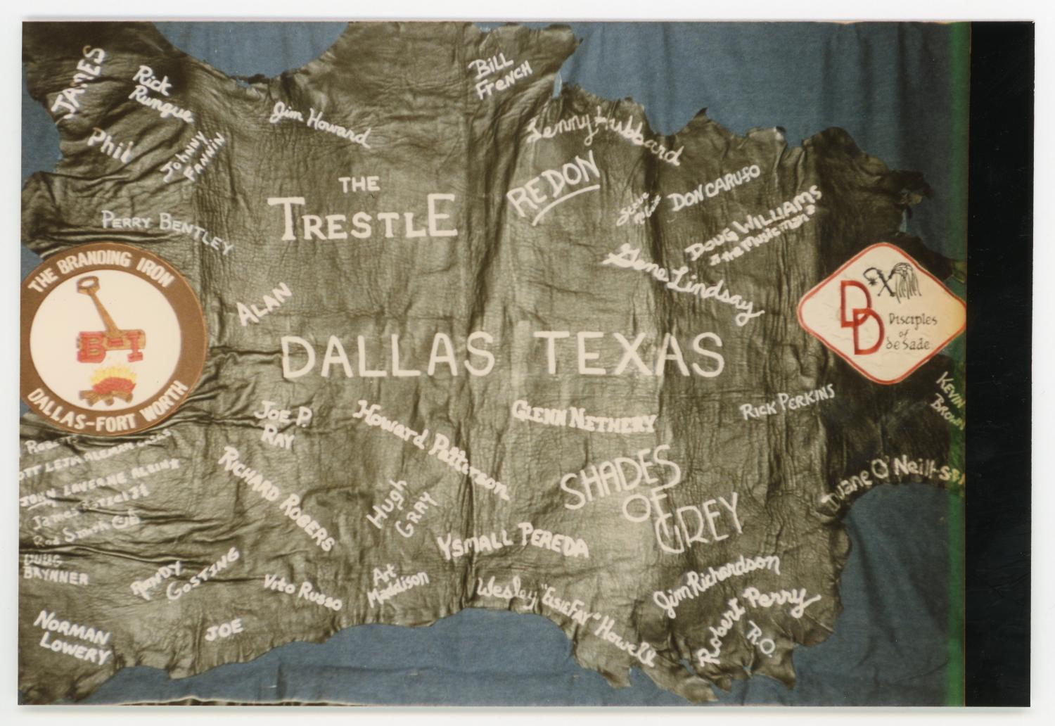 """[Quilt Section from The Trestle], Photograph of a section of the AIDS memorial quilt from The Trestle. Names include Rick Rungue, Perry Bentley, Johnny Fannin, Doug Brynner, Norman Lowery, Randy Gosting, Jim Howard, Joe P. Ray, Richard Rogers, Vito Russo, Howard Pattison, Hugh Gray, Art Maddison, Bill French, Glenn Nethery, Ysmall Pereda, Wesley """"Elsiefay"""" Howell, Don Caruso, Doug Williams, Gene Lindsay. Jim Richardson, Robert Perry, Rick Perkins, Duane ONeill, and Kevin Brown.,"""