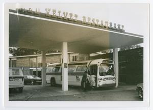 Primary view of object titled '[Bus at Holiday Inn]'.