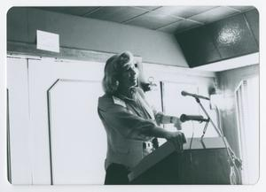 Primary view of object titled '[Willa K. Baum Standing at Podium]'.