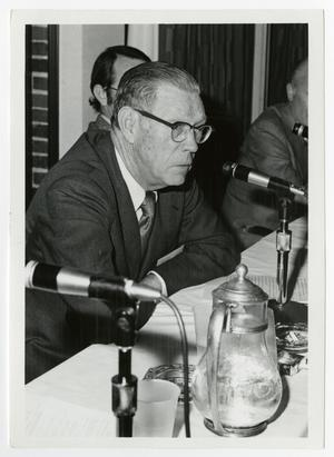 Primary view of object titled '[Man Sitting in Front of Microphone]'.
