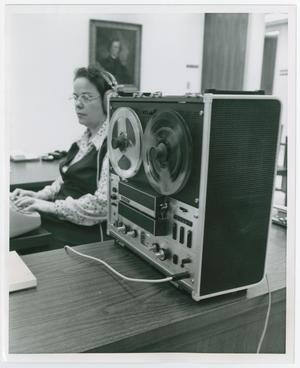 Primary view of object titled '[Woman Transcribing Tape]'.