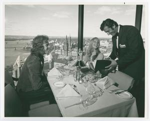 Primary view of object titled '[Two People Seated at a Table at La Ronde Rotating Restaurant]'.
