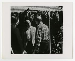 Primary view of object titled '[Men Standing Outdoors Talking]'.