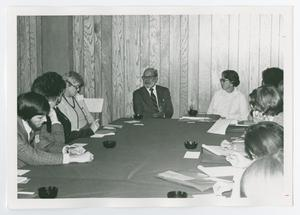 Primary view of object titled '[Group of Ten People Seated at a Table]'.