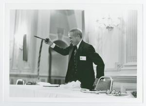 Primary view of object titled '[Man Holding a Gavel and a Tie]'.