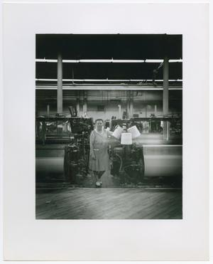 Primary view of object titled '[Bette Surzyszowsui Standing in a Factory]'.