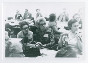 Primary view of object titled '[Women Sitting in a Room with Others]'.