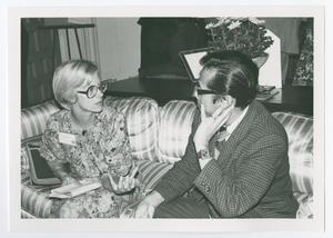Primary view of object titled '[Mary Jo Deering and Sam Tan Having a Discussion]'.