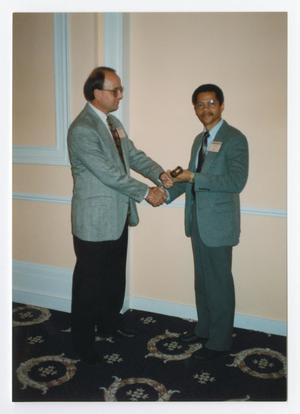 Primary view of object titled '[Two Men in Suits Shaking Hands]'.