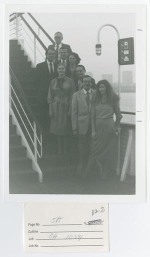Primary view of object titled '[Eight People Posing on Stairs Outside]'.