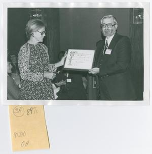 Primary view of object titled '[Two Persons Holding Diploma]'.