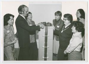 Primary view of object titled '[Greenwich Library Director with Several Women]'.