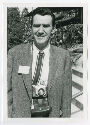 Primary view of object titled '[James Mink Wearing a Camera and Smiling]'.