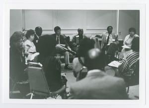 Primary view of object titled '[Sitting Group Discussion]'.