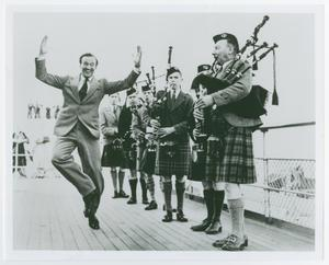 Primary view of object titled '[Man Dancing to Bagpipe Music]'.
