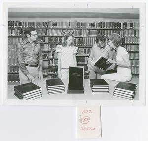 "Primary view of object titled '[Four People with Book Titled ""East Texas Bicentennial Oral History Consortium]'."