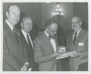 Primary view of object titled '[Photograph of Daniel Boorstin and Charles T. Morrissey with Recorder and Transcript]'.