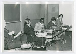Primary view of object titled '[Five People Seated at a Table with Recording Devices]'.