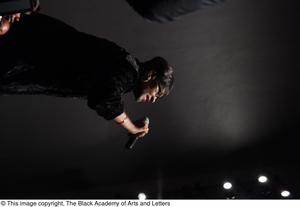 Primary view of object titled '[Unidentified Lead Singer on Stage]'.