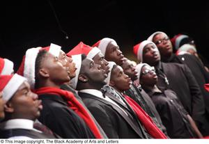 Primary view of object titled '[Side View of Choir Members Singing on Stage]'.