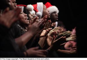 Primary view of object titled '[Choir Members Singing and Clapping on Stage]'.