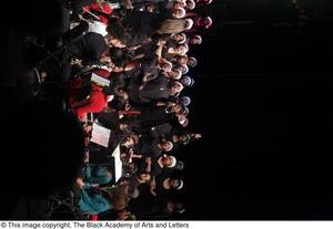 Primary view of object titled '[Chorus Singing with Soloist on Stage]'.
