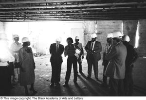 Primary view of object titled '[Curtis King and Others Inside Lamar St. Building]'.