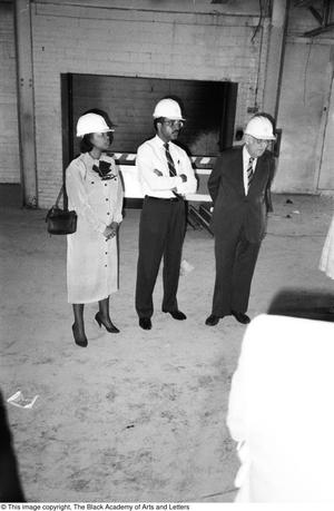 Primary view of object titled '[Three People Inside Building on Lamar St.]'.
