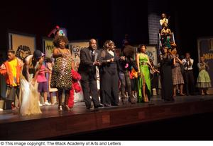 Primary view of object titled '[Erykah Badu and Jennifer Holliday on Stage with Performers]'.