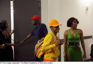 Primary view of object titled '[Erykah Badu with Unidentified Persons]'.